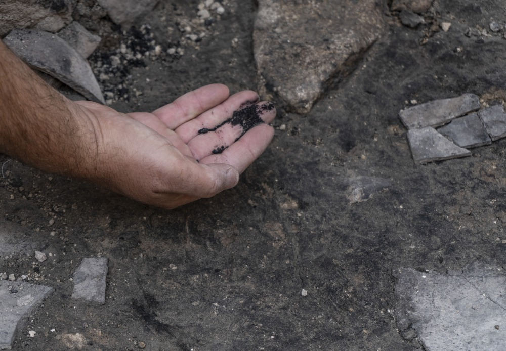 Ashes from The destruction at the site. Photographer Shai Halevi Israel Antiquities Authority