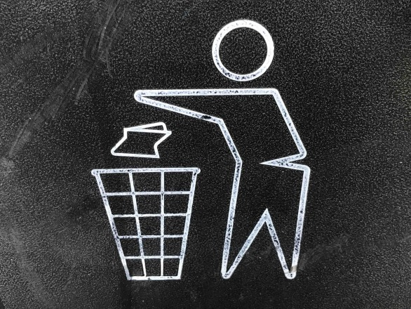 Close up of a recycle garbage bin logo. by gary chan, unsplash