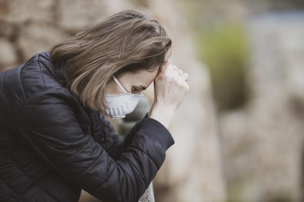 Woman wearing face mask during coronavirus outbreak. by engin akyurt